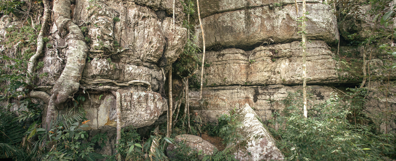 Photo A tiny soldier stands amid a giant rock formation in the bushland outside San José del Guaviare