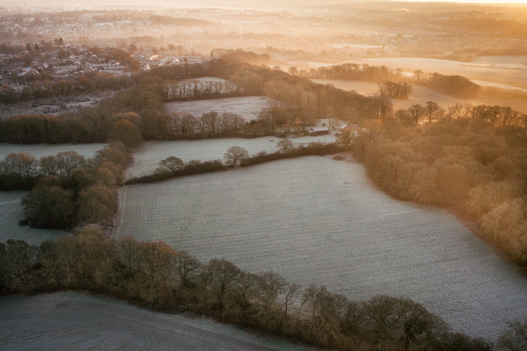 Photo Aerial views of the family farm. Sunrise on a frosty morning.